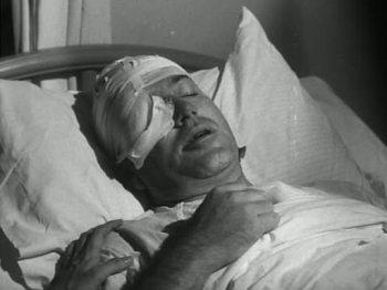 Tom McDaniel (Frank Maxwell) dans The Intruder
