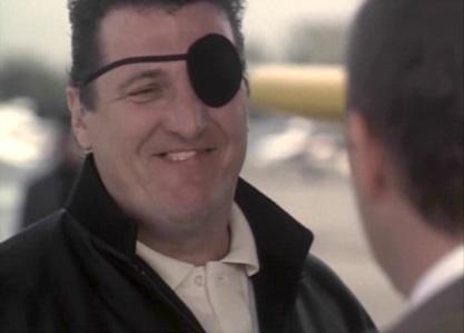 "Tony (Michael ""Mike"" Starr) dans The Bodyguard"