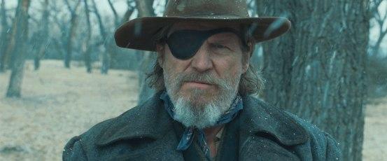 Marshal Reuben J. « Rooster » Cogburn (Jeff Bridges) dans True Grit